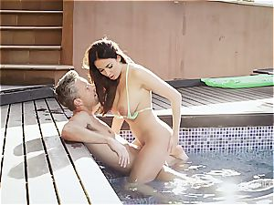 huge-boobed wonder babe Anissa rides a dick by the pool