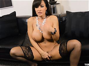 Lisa Ann pushes her dildo deep in her wet muff