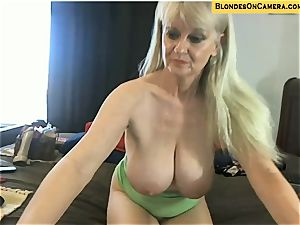 blond mature goes all mischievous in all slots on cam