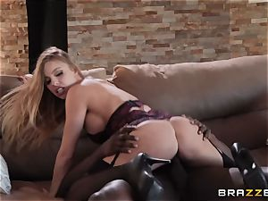 Britney Amber juggling on top
