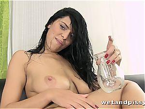 big-chested Elena Rae urinates through her stocking