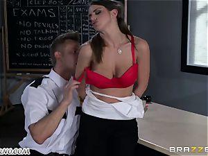 Policeman punishes mischievous schoolgirl on the table