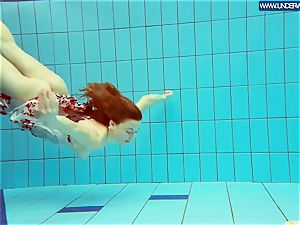 hot grind ginger-haired swimming in the pool