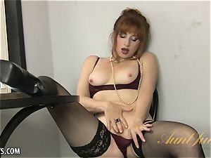 Amber Dawn elations herself wearing thigh highs.